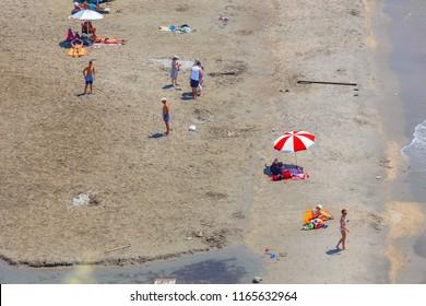 GITHIO, LAKONIA - JULY 2017: Various people having fun at the sandy beach near Githio, Lakonia, Greece
