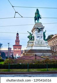 Giuseppe Garibaldi statue in Largo Cairoli square with the Filarete Tower of the Castello Sforzesco in background at sunset. Milan, Lombardy, Italy.