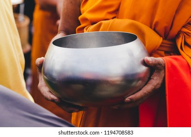 Give Alms to the monks. Give food to the monks. Offerings in a monk's Alms bowl . In the morning, Thailand.