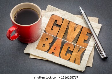 give back inspirational word abstract in vintage letterpress wood type ona napkin with a cup of coffee, give back to society or community concept