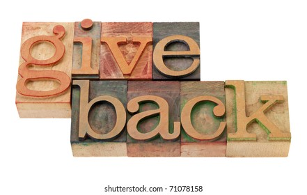 give back - words in vintage wooden letterpress printing blocks, stained by color inks, isolated on white