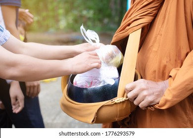 Give Food To The Monks. Give Alms To The Monks. Offerings In A Monk's Alms Bowl. People Give Alms To A Buddhist Monk In Morning, Thailand. Image For Graphic, Banners, Presentations,Reports, Wallpaper.