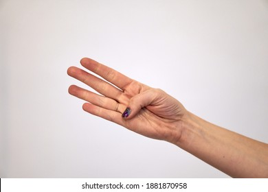 Give four. Right palm Caucasian female hand shows fingers and the thumb is bent. Hand brush on a white background.