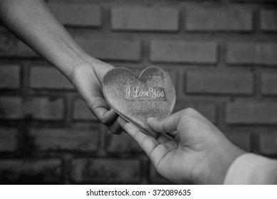 Give heart from hand to hand back and white style,dark