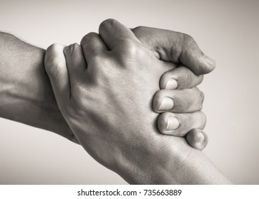 Give a helping hand. Unity, salvation.