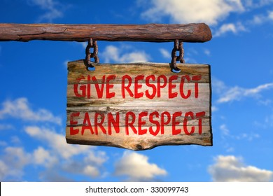 Give respect, earn respect motivational phrase sign on old wood with blurred background
