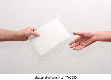 Give someone money in envelop for corruption purposes