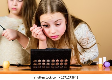 Give your lashes some extra flutter. Adorable kids doing eye lashes makeup. Little girls applying mascara on lashes. Small child using cosmetic for enhancing eye lashes.