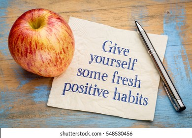 Give yourself some fresh positive habits - motivational handwriting on a napkin with an apple