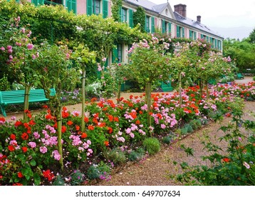 GIVERNY, FRANCE -3 JULY 2016- The house of French impressionist painter Claude Monet in Giverny is now a museum. It includes a beautiful garden with a nymphea waterlily pond and Japanese bridge.