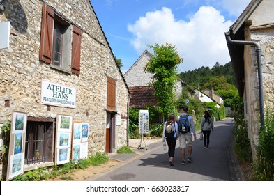 GIVERNY, FRANCE - AUG 5:  Tourists walk down a street in Giverny, France, home of artist Claude Monet, on August 5, 2016.