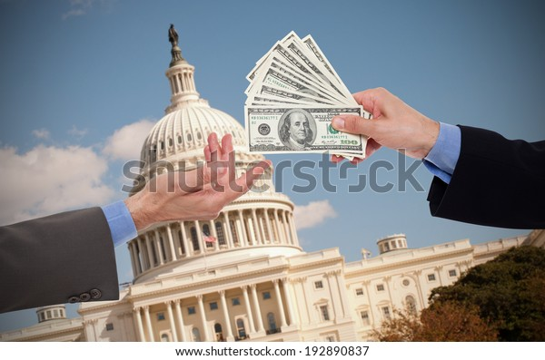 Giving a bribe, hands of businessmen or politicians