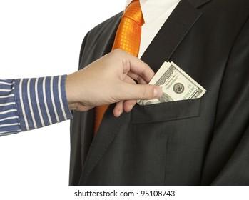 Giving a bribe into a pocket, horizontal shot  (Dollar banknotes)