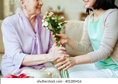 Giving bunch of fresh roses