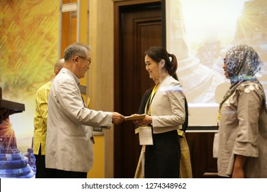 giving certificate for asian woman on stage. receiving a certificate. yogyakarta indonesia. january 04, 2019.