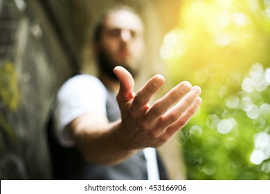 Giving a helping hand, asking or offering help close-up shot of a Caucasian man in a business suit.