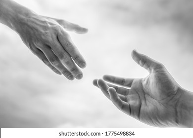Giving a helping hand to a friend in need. Hand reaching out to another.