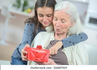 Giving her grandma a gift