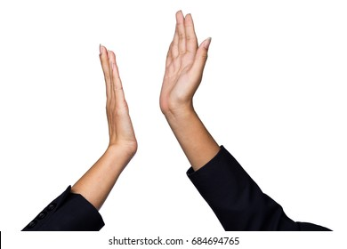 ?Businesswoman giving hi five or touching hands for celebration business achievement and success with teamwork isolated on white background. Two hands of Asian people making hi-five gesture.