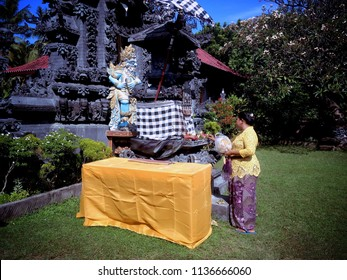 Giving Offerings To God At Dalem Temple In The Holy Kuningan Day Ringdikit Village