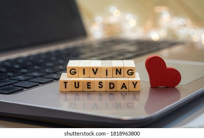 GIVING TUESDAY letter blocks concept on laptop keyboard