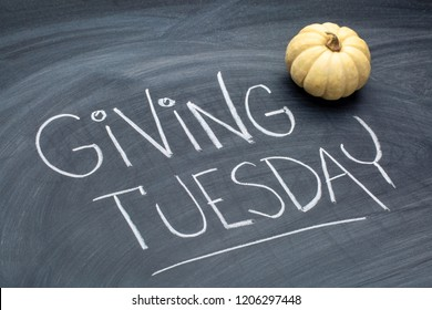 Giving Tuesday  - white chalk handwriting on a  blackboard  with ornamental gourd