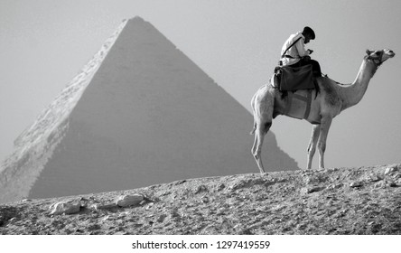 GIZA, EGYPT 11 15 10: Uniformed Tourist Police patrols the Great Pyramid of Giza or Kufu or Cheops. The world's oldest tourist attraction, the Pyramids of Giza are nearly 5000 years old.