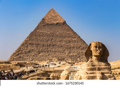 Giza, Egypt - 23rd Dec 2019: The Great Sphinx of Giza and in the background the Pyramid of Khafre visited by tourists from all over the world