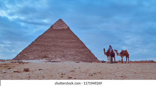 Giza / Egypt - 24/4/2018 : A Bedouin and a tourist beside the pyramids.