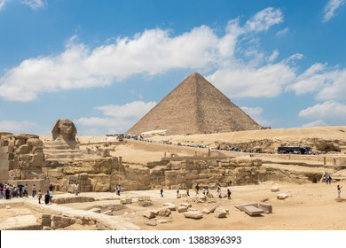Giza, Egypt - April 19, 2019: The pyramid of Khufu and the Great Sphinx of Giza, Egypt