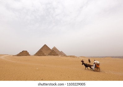 GIZA, EGYPT, APRIL 20: Tourists travelling in desert and dunes to see the Pyramids at Giza complex, Cairo, Egypt on April 20, 2018