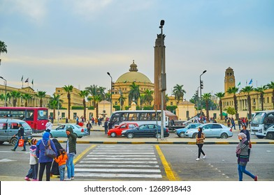 GIZA, EGYPT - DECEMBER 19, 2017: The busy bus station in front of the building of Faculty of Arts of Cairo University, on December 19 in Giza.