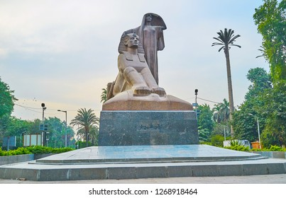 GIZA, EGYPT - DECEMBER 19, 2017: Impressive Nahdet Masr statue or Egypt's Awakening represents the peasant woman and Sphinx, surrounded by lush greenery of the garden, on December 19 in Giza.