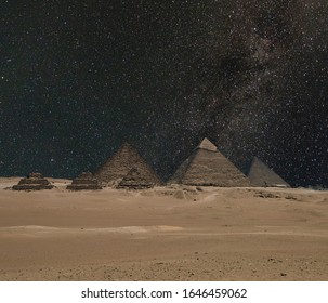 The Giza pyramid complex on the Giza Plateau in Egypt near Cairo includes the Great Pyramid of Giza the Pyramid of Khafre and the Pyramid of Menkaure under night starry sky. Composite image.