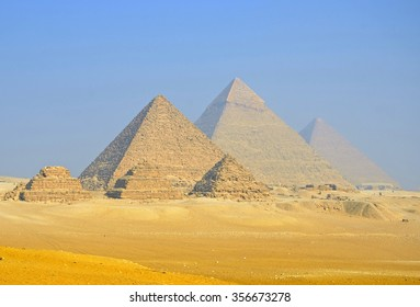 GIZA,EGYPT - DECEMBER 8 2015: Giza pyramid complex includes three pyramid complexes known as Pyramid of Khufu,Karfe and Menkaura and Egyptologists believe that they were built around 2560 BC.
