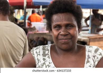Gizo, Solomon Island - March 11th, 2017: Portrait of a woman selling lemons at the Gizo Fish Market.