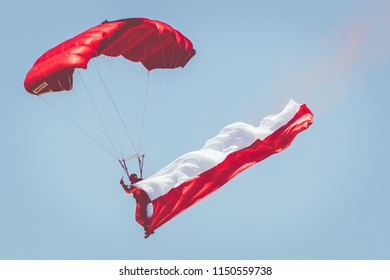 GIZYCKO, POLAND - AUGUST 5, 2018: Parachutist with the Polish flag at Air Show Mazury 2018 event at the lake Niegocin in Gizycko. Poland.