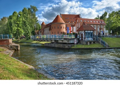 GIZYCKO, POLAND - JULY 07: Four stars St. Bruno Hotel made in medieval Teutonic Knights castle and open Swing Bridge on Luczanski Canal on July 07, 2016 in Gizycko, Poland
