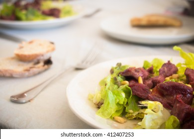 gizzards plate with salad on a table prepared