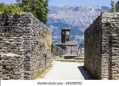 GJIROKASTER, ALBANIA - July 2017: Clock tower in Gjirokaster castle, ottoman architecture in Albania, Unesco World Heritage Site, Gjirocaster ancient town, Albania