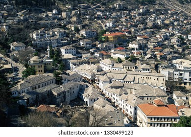 Gjirokaster, Albania - March, 2019: Downtown of Gjirokaster, a UNESCO World Heritage site in south of Albania, Old Ottoman Bazaar, aerial view from city castle