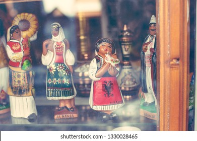 Gjirokaster, Albania - March 2019: Old Ottoman market traditional wooden handmade dolls for sale, souvenir from Albania.