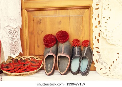 Gjirokaster, Albania - March 2019: Old Ottoman market traditional wool shoes for sale, souvenir from Albania.