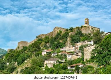 Gjirokaster Castle and clock tower with Ottoman houses below in Gjirokaster, Albania