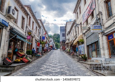 Gjirokaster/Albania - September 20 2016: Historical UNESCO protected town of Gjirocaster , Southern Albania. Paved road leading up to the hill with tourist shops