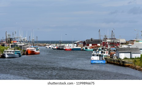 Glace Bay, NS, Canada - August 2, 2018: The picturesque harbour of Glace Bay, Cape Breton with many fishing boats.