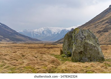 A Glacial erratic stands tall in the Valley floor at Glen Esk in the Angus Glens, on one cold Winter's day.