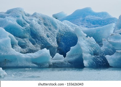 Glacial fragments floating in a lagoon.