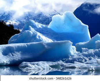 Glacial ice can have many shapes and forms and reflects beautiful shades of blues, grays and greens.
