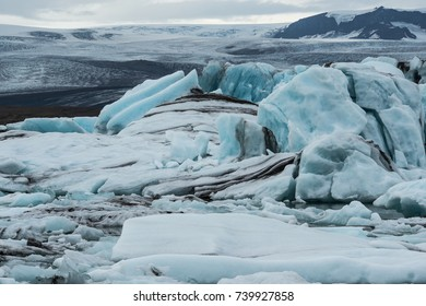Jökulsárlón is a glacial lagoon, bordering Vatnajökull National Park in southeastern Iceland. Its still, blue waters are dotted with icebergs from the surrounding Breiðamerkurjökull Glacier..